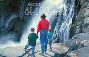 Alaska. Seward. A mom and her twins enjoy a waterfall very close to the town of Seward.
