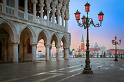 """Doge's Palace s at Piazza San Marco in Venice, Italy<br /> .....<br /> Venice is a city in northeastern Italy sited on a group of 118 small islands separated by canals and linked by bridges. It is located in the marshy Venetian Lagoon which stretches along the shoreline, between the mouths of the Po and the Piave Rivers. Venice is renowned for the beauty of its setting, its architecture and its artworks. The city in its entirety is listed as a World Heritage Site, along with its lagoon. Venice is the capital of the Veneto region. In 2009, there were 270,098 people residing in Venice's comune. Although there are no historical records that deal directly with the founding of Venice, tradition and the available evidence have led several historians to agree that the original population of Venice consisted of refugees from Roman cities near Venice such as Padua, Aquileia, Treviso, Altino and Concordia (modern Portogruaro) and from the undefended countryside, who were fleeing successive waves of Germanic and Hun invasions. Some late Roman sources reveal the existence of fishermen on the islands in the original marshy lagoons. They were referred to as incolae lacunae (""""lagoon dwellers""""). The traditional founding is identified with the dedication of the first church, that of San Giacomo at the islet of Rialto (Rivoalto, """"High Shore""""), which is said to have been at the stroke of noon on 25 March 421."""
