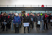 The Pandemonium Drummers from the London 2012 Olympic Ceremonies perform Symphony of Waves created for the Armistice Day centenary remembrance event 'Pages of the Sea' on Folkestone Harbour Arm, Folkestone Kent. 11th November 2018. Presented by over 40 drummers, the semi-improvised piece explores the concern, anxiety, and commitment of those who left home and started a journey across the sea to fight in World War One, from which many did not return. Performed on buckets and bins is is designed to evoke memories of a pleasant land left behind and outlooks of an uncertain future.