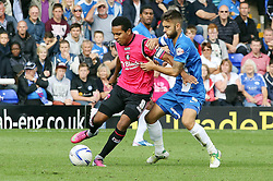 Oldham Athletic's Korey Smith in action with Peterborough United's Jack Payne  - Photo mandatory by-line: Joe Dent/JMP - Tel: Mobile: 07966 386802 17/08/2013 - SPORT - FOOTBALL - London Road Stadium - Peterborough -  Peterborough United V Oldham Athletic - Sky Bet League One