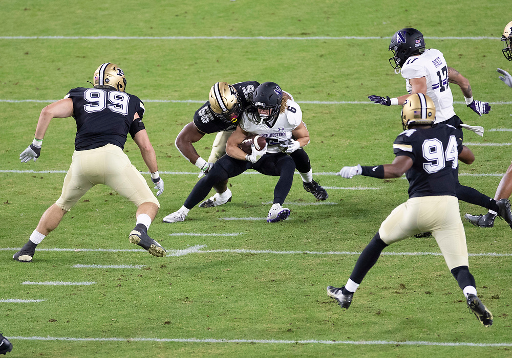 November 14, 2020:  Northwestern running back Drake Anderson (6) runs with the ball as Purdue defenders pursue during NCAA football game action between the Northwestern Wildcats and the Purdue Boilermakers at Ross-Ade Stadium in West Lafayette, Indiana. Northwestern defeated Purdue 27-20.  John Mersits/CSM.