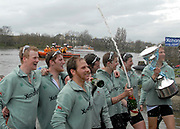 Putney, London,  CUBC, Cambridge Blue Boat Crew, celebrate, with Boat Race Trophy, 156th University Boat Race, River Thames, between Putney and Chiswick, on the Championship Course.  Saturday  03/04/2010 [Mandatory Credit Karon Phillips/Intersport Images]<br /> CUBC Crew, Bow - Rob WEITEMEYER, Geoff ROTH, George NASH, Peter McCELLAND, Deaglan McEACHERN, Henry PELLY, Derek RASMUSSEN, Stroke - Fred GILL and Cox - Ted RANDOLPH