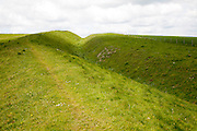 Ditch and embankment of the Wansdyke a Saxon defensive structure on All Cannings chalk downs, Tan Hill, Wiltshire, England
