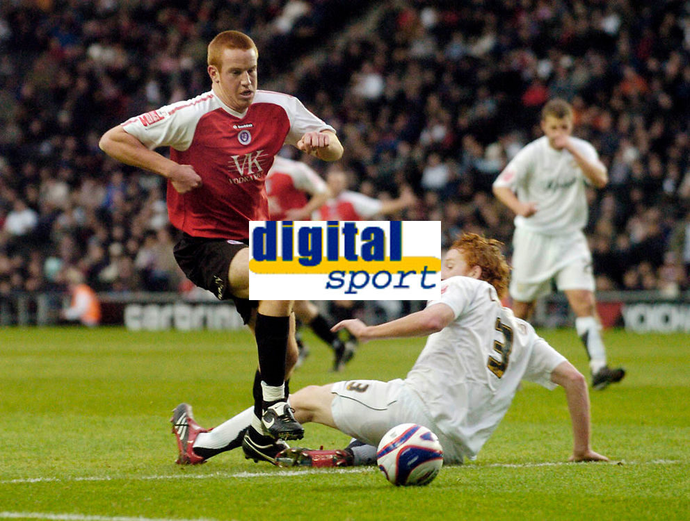 Photo: Leigh Quinnell/Sportsbeat Images.<br /> Milton Keynes Dons v Chesterfield. Coca Cola League 2. 24/11/2007. Chesterfields Adam Rooney leaves MK Dons Dean Lewington on the floor.