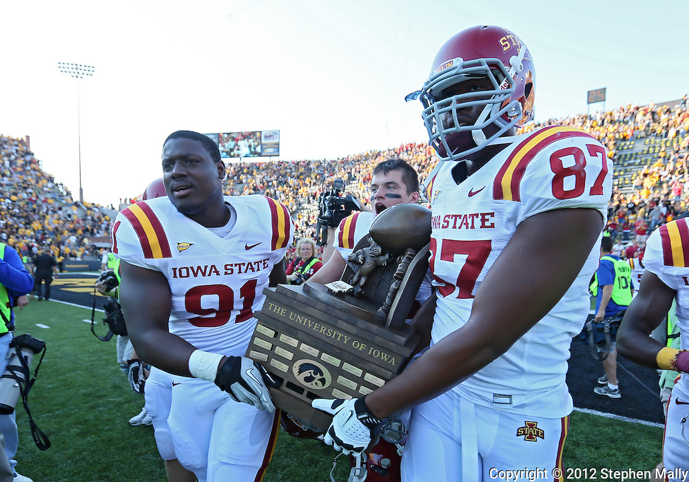 September 08 2012: Iowa State Cyclones defensive end Pierre Aka (91) and Iowa State Cyclones defensive end David Irving (87) hold Cy-Hawk trophy after the NCAA football game between the Iowa State Cyclones and the Iowa Hawkeyes at Kinnick Stadium in Iowa City, Iowa on Saturday September 8, 2012. Iowa State defeated Iowa 9-6.