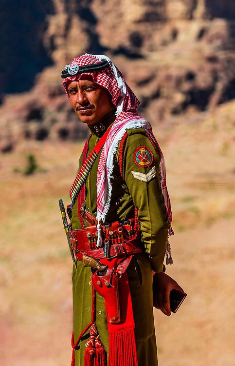 A Bedouin Desert Patrol policeman, at the Royal Tombs,  Petra archaeological site (a UNESCO World Heritage site), Petra, Jordan.
