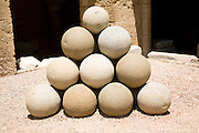 Stone sling shot balls, Archaeological museum, Rhodes, Greece