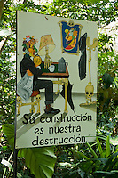 """Sign at Zoo Ave, a zoo near San Jose, Costa Rica, specializing in native birds, promotes rainforest conservation with the slogan """"Your construction is our destruction."""""""