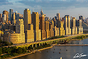 Aerial view of Riverside Boulevard in New York City at sunset, photographed from a helicopter over the Hudson River.