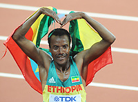 Athletics - 2017 IAAF London World Athletics Championship - Day Thirteen, Evening Session<br /> <br /> Men's 5000m Final<br /> <br /> Muktar Edris of Ethiopia does the 'Mo Bot' after winning the Gold medal ahead of Mo Farah of Great Britain at the London Stadium.<br /> <br /> COLORSPORT/ANDREW COWIE