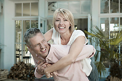 Couple married garden middle aged fun playful