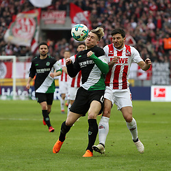 COLOGNE, Feb. 18, 2018  Felix Klaus (L) of Hannover and Milos Jojic of Koeln vie for the ball during the Bundesliga match between 1. FC Koeln and Hannover 96 in Cologne, Germany, on Feb. 17, 2018. The match ended with a tie 1-1. (Credit Image: © Ulrich Hufnagel/Xinhua via ZUMA Wire)