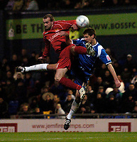 Photo: Jed Wee.<br />Oldham Athletic v Chasetown. The FA Cup. 16/11/2005.<br /><br />Chasetown's Lee Bullimore (L) jumps with Oldham's Danny Hall.