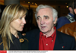French singer Charles Aznavour and his daughter Katia attend the screening of the movie Tirez sur le pianiste as part of the 19th Paris Film Festival, in Paris on Friday April 2, 2004. Photo by Laurent Zabulon/ABACA.