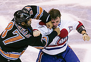 Washington Capitals Donald Brashear (L) lands a punch on Montreal Canadiens Aaron Downey in a fight during second period NHL action in Washington.   <br /> REUTERS/Jim Young