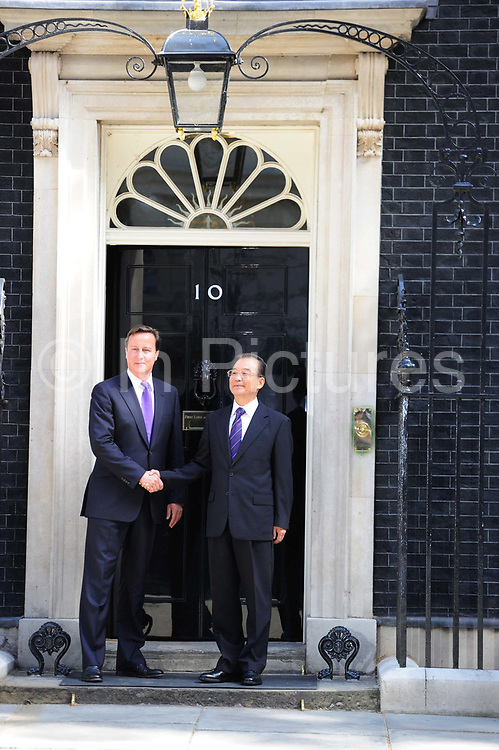Britain's Prime Minister David Cameron greets Chinese Premier Wen Jiabao at number 10 Downing Street in London in a recent diplomatic / trade discussion visit between China and the UK.