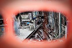 Potenza (PZ), 23-11-2010 ITALY - Il quartiere Bucaletto. Bucaletto è un quartiere popolare della periferia est di Potenza. Fu progettato all'indomani del terremoto dell'Irpinia del 23 novembre 1980, per risolvere i problemi delle famiglie sfollate a causa dei crolli di alcune abitazioni della città, difatti è caratterizzato dalla presenza di abitazioni singole, in prefabbricati..Nella Foto: Alcuni moduli abitativi in legno in corso di demolizione.