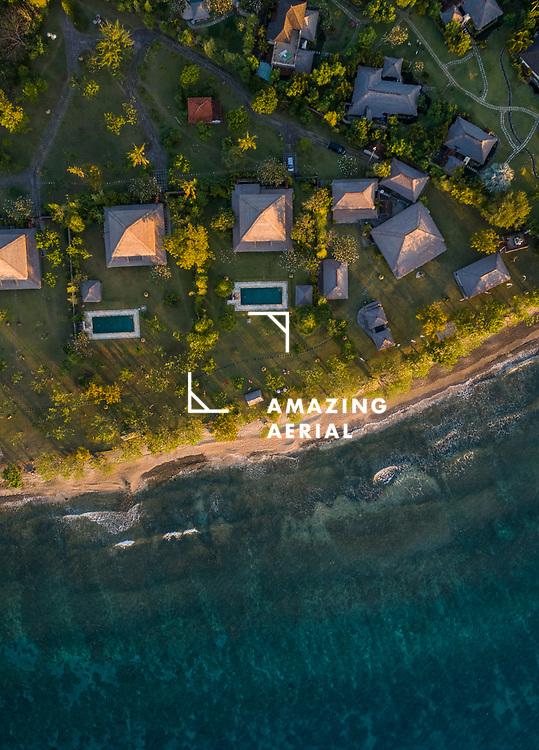 GEROKGAK, BALI - 21 AUGUST 2017: Aerial view of Puri Ganesha Homes with swimming pools by coast, Gerokgak, Bali.
