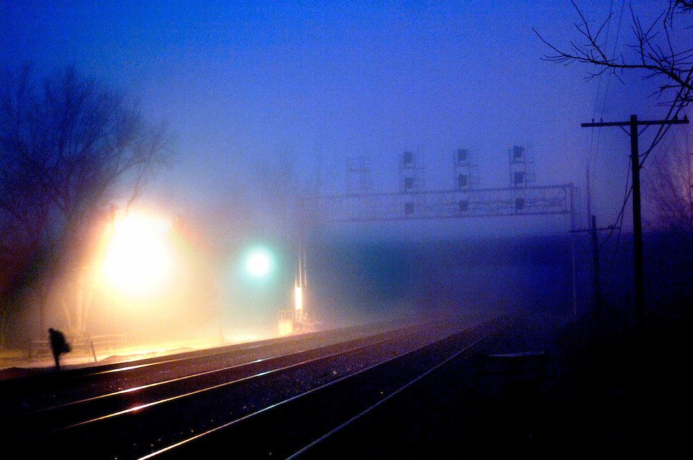 (Photo by Matt Roth)..A commuter walks to the St. Denis stop Friday morning January 13, 2005 to await the 6:51AM southbound MARK train. This will be one of the stops closing in March.