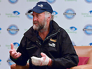 """© Licensed to London News Pictures. 04/03/2013. Heathrow, UK SIR RANULPH FIENNES with a bandaged left hand. Explorer Sir Ranulph Fiennes returns to the UK after pulling out of """"The Coldest Journey"""" Expedition to the Antarctic at winter due to frostbite. The Coldest Journey Press Conference today 4th March 2013 at Heathrow Airport. Photo credit : Stephen Simpson/LNP"""