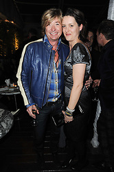 NICKY CLARKE and LORRAINE GODDARD at a party following a private view of photographs by Lorraine Goddard entitled 'Out of Context' held at the Sanderson Hotel, Berners Street, London on 21st January 2010.