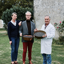 Xavier Desforges, surrounded by his parents outside Maison Caulieres' farm. Dolus-le-Sec, France. October 7, 2019.
