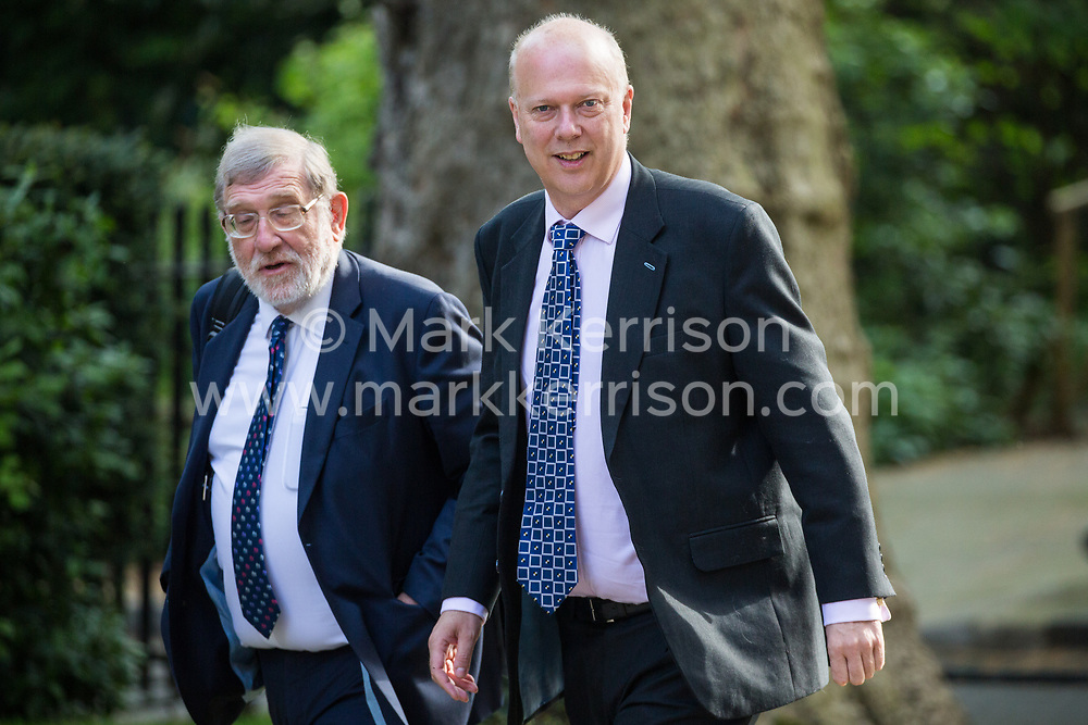 London, UK. 7 May, 2019. Chris Grayling MP, Secretary of State for Transport, arrives at 10 Downing Street for a Cabinet meeting.