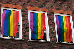 London, UK. 30th April 2019. The Admiral Duncan pub in Old Compton Street, Soho, is decorated with rainbow flags, or LGBT pride flags, for an event involving survivors of the Admiral Duncan bombing, families and friends of the victims and the LGBTQ community to mark 20 years since the attack. Three people were killed and 79 injured when a bomb packed with up to 1,500 four-inch nails was detonated by a neo-Nazi at the Admiral Duncan on 30th April 1999.