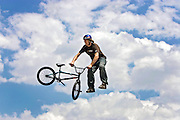 Adam Baker, 26, of Prescott, Az. performs a tail whip off a jump during the BMX Dirt Open Qualifier at the Dew Action Sports Tour, the only season-long professional action sports tour. The event will make its second stop of the season in Denver with the Right Guard Open taking place Thursday July 13 through Sunday July 16, 2006 in and around the Pepsi Center. Athletes were already in town for practice sessions and qualifying rounds on Wednesday July 12, 2006..(MARC PISCOTTY/ © 2006)