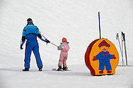 Mother and child Skiing - Insbruck - Austrian Tyrol .<br /> <br /> Visit our SWITZERLAND  & ALPS PHOTO COLLECTIONS for more  photos  to browse of  download or buy as prints https://funkystock.photoshelter.com/gallery-collection/Pictures-Images-of-Switzerland-Photos-of-Swiss-Alps-Landmark-Sites/C0000DPgRJMSrQ3U