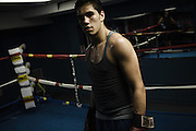BETHLEHEM, PA – MAY 31, 2011: Seventeen year-old Cody Coronado trains with athletic coach Tom Gazzana at the Bethlehem Boxing Club, located at 502 East 4th Street in Bethlehem, Pennsylvania. Coronado is half caucasian, half dominican.<br /> <br /> As the population of second and third generation Hispanics increases dramatically in the United States, a new boldness can be sensed among Latinos in America, stretching far beyond the southern border states. Demographers in Pennsylvania say the towns of Bethlehem, Allentown and Reading are set to become majority-minority cities, where Hispanics comprise a bigger portion of the population than whites. As this minority population increases dramatically in the region, Latinos are inching closer to their own realization of the American Dream, while gradually shifting the physical and cultural landscapes of their communities.