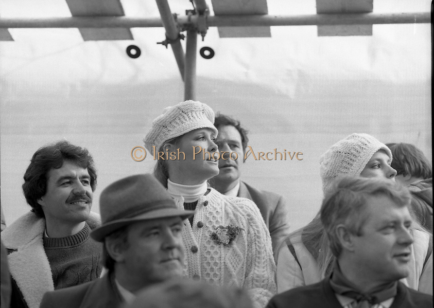 """St Patrick's Day Parade.1982.17/03/1982.03.17.1982.17th March 1982..Image of a famous face in the crowd. The actress Susan Howard a star in the TV series """"Dallas"""" views the parade. She is accompanied by her husband Mr Calvin Crane,seated to her right."""