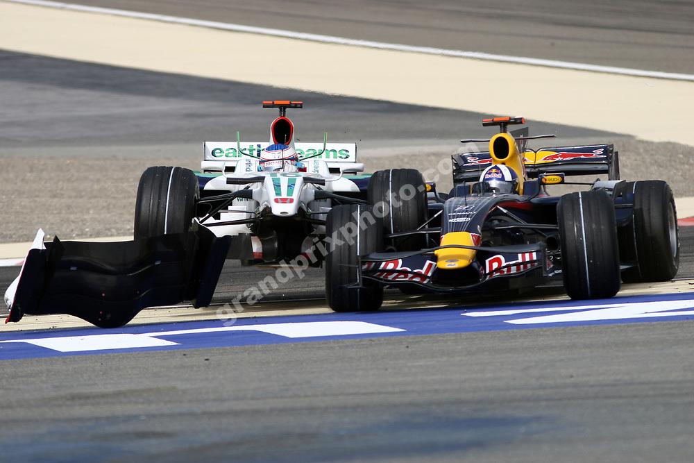 Jenson Button (Honda) and David Coulthard (Red Bull-Renault) crash in the 2008 Bahrain Grand Prix. Photo: Grand Prix Photo