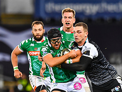 Ian McKinley of Benetton Treviso is tackled by George North of Ospreys<br /> <br /> Photographer Craig Thomas/Replay Images<br /> <br /> Guinness PRO14 Round 4 - Ospreys v Benetton Treviso - Saturday 22nd September 2018 - Liberty Stadium - Swansea<br /> <br /> World Copyright © Replay Images . All rights reserved. info@replayimages.co.uk - http://replayimages.co.uk