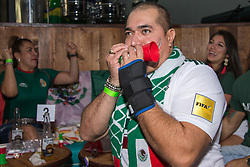 July 2, 2018 - FL, USA - Mexico fan Jose Luis reacts to a goal opportunity during FIFA World Cup Round of 16 knockout stage featuring Brazil versus Mexico at Vares in Brickell on Monday, July 2, 2018. (Credit Image: © Sam Navarro/TNS via ZUMA Wire)