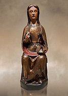 Gothic wood statue of Saint Lucy by the St Bertrand de Cominges Group of artists. Polychrome wood carving with varnished metal-plating.  National Museum of Catalan Art, inv no: 064013-000 .<br /> <br /> If you prefer you can also buy from our ALAMY PHOTO LIBRARY  Collection visit : https://www.alamy.com/portfolio/paul-williams-funkystock/gothic-art-antiquities.html  Type -     MANAC    - into the LOWER SEARCH WITHIN GALLERY box. Refine search by adding background colour, place, museum etc<br /> <br /> Visit our MEDIEVAL GOTHIC ART PHOTO COLLECTIONS for more   photos  to download or buy as prints https://funkystock.photoshelter.com/gallery-collection/Medieval-Gothic-Art-Antiquities-Historic-Sites-Pictures-Images-of/C0000gZ8POl_DCqE