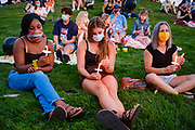 21 JULY 2020 - DES MOINES, IOWA: People hold candles during a memorial and vigil honoring Congressman John Lewis (D-GA). About 300 people attended a vigil for Representative Lewis in Poppajohn Sculpture Park in Des Moines Tuesday night. Rep. Lewis died from pancreatic cancer on July 17, 2020.             PHOTO BY JACK KURTZ