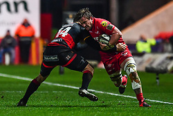 Scarlets' Will Boyde is tackled by Dragons' Pat Howard<br /> <br /> Photographer Craig Thomas/Replay Images<br /> <br /> Guinness PRO14 Round 13 - Scarlets v Dragons - Friday 5th January 2018 - Parc Y Scarlets - Llanelli<br /> <br /> World Copyright © Replay Images . All rights reserved. info@replayimages.co.uk - http://replayimages.co.uk