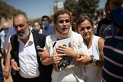 © Licensed to London News Pictures. 17/08/2020. Beirut, Lebanon. A family member reacts as funeral procession for three firefighters Charbel Hitti, cousin Najib Hitti and uncle Charbel Karam, who died in the huge explosion in Beirut Port on 4 August, makes its way through Bir El Hait, a mountainous region of Lebanon, before arriving at the family's home town of Qartaba for a funeral and ceremony. The three family members were said to be best friends. Photo credit : Tom Nicholson/LNP