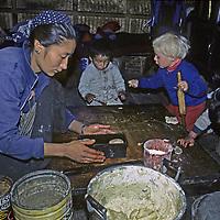 NEPAL, HIMALAYA, 3-year old Ben Wiltsie helps Sherpa innkeeper & children to make bread, Namche Bazar.
