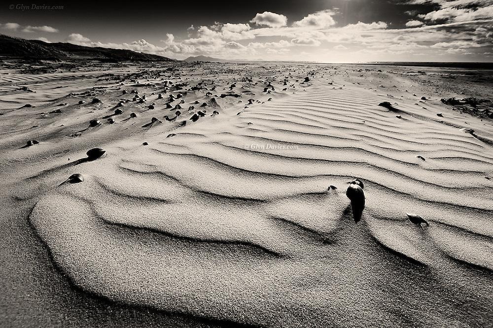 Wind blown sand ripples at the mouth of the Malltraeth Estuary where it joins the Irish Sea at Llanddwyn Beach