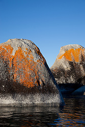 """""""Boulders on Lake Tahoe 21"""" - These orange, black, and grey boulders were photographed in the early morning near Speedboat Beach, Lake Tahoe."""