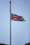 The Union flag waves at half-mast as people observe a minute's silence outside Buckingham Palace in central London on Saturday, April 17, 2021, during the funeral of Prince Philip of the United Kingdom.  The Queen announced the death of her beloved husband, His Royal Highness Prince Philip, Duke of Edinburgh who died at age 99. HRH passed away peacefully on April 9th at Windsor Castle after 73 years of marriage to Britain's Queen Elizabeth II. (Photo/ Vudi Xhymshiti)