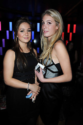 Left to right, LADY MARINA-CHARLOTTE WINDSOR and TATIANNA CHENEVIERE at the Tatler Little Black Book Party held at Chinawhite, 4 Winsley Street, London on 20th November 2009.