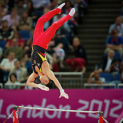 Germany's Marcel Nguyen reached for the high bar during his silver medal performance in the men's individual all-around finals at North Greenwich Arena during the 2012 Summer Olympic Games in London, England, Wednesday, August 1, 2012. (David Eulitt/Kansas City Star/MCT)