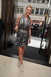 TESS DALY at a reception hosted by Vogue and Burberry to celebrate the launch of Fashions Night Out - held at Burberry, 21-23 Bond Street, London on 10th September 2009.