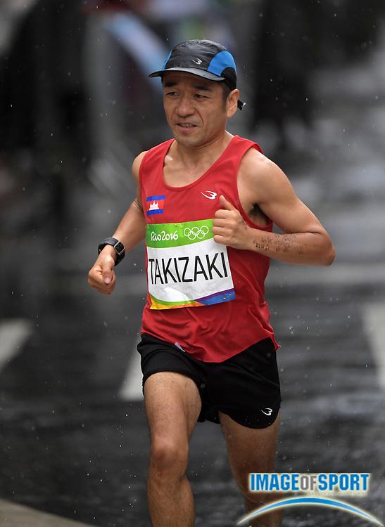 Aug 21, 2016; Rio de Janeiro, Brazil; Kuniaki Takizaki (CAM) places 139th in 2:45:55 in the marathon during the Rio 2016 Summer Olympic Games at Sambodromo.