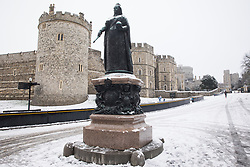 The first snowfall of winter lies around the Queen Victoria statue outside Windsor Castle on 24th January 2021 in Windsor, United Kingdom. The current spell of cold weather is expected to continue for another two or three days.