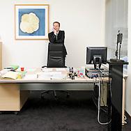 Nederland, Den Helder, 20081203..Chris van Meurs staande in zijn werkruimte. Lid van het College van Bestuur van de Scholen aan Zee.