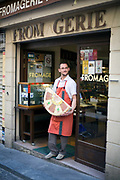 Hugues Foucher with a cheese outside his shop on the Rue Mouffetard.<br /> Rue Mouffetard is in the Fifth (cinquieme) arrondisement and the street is one of the oldest in Paris. A Roman road, it originally ran from the Roman Rive Gauche city all the way to Italy. Today, the market is famous for it's quality fresh produce and artisanal food shops.